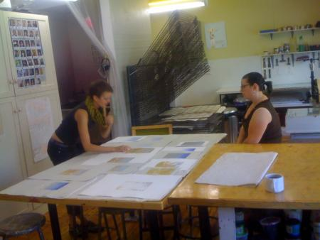 image: Silkscreen and Intaglio room.  Keymember working with an Artist to curate an edition they worked on together.